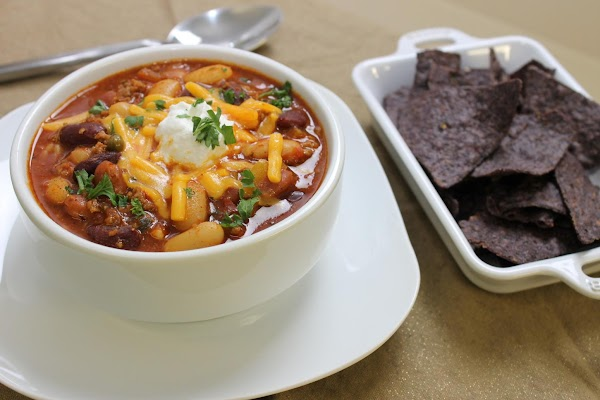 Step 3 To serve, spoon chili into bowls and top with sharp cheddar cheese, a...