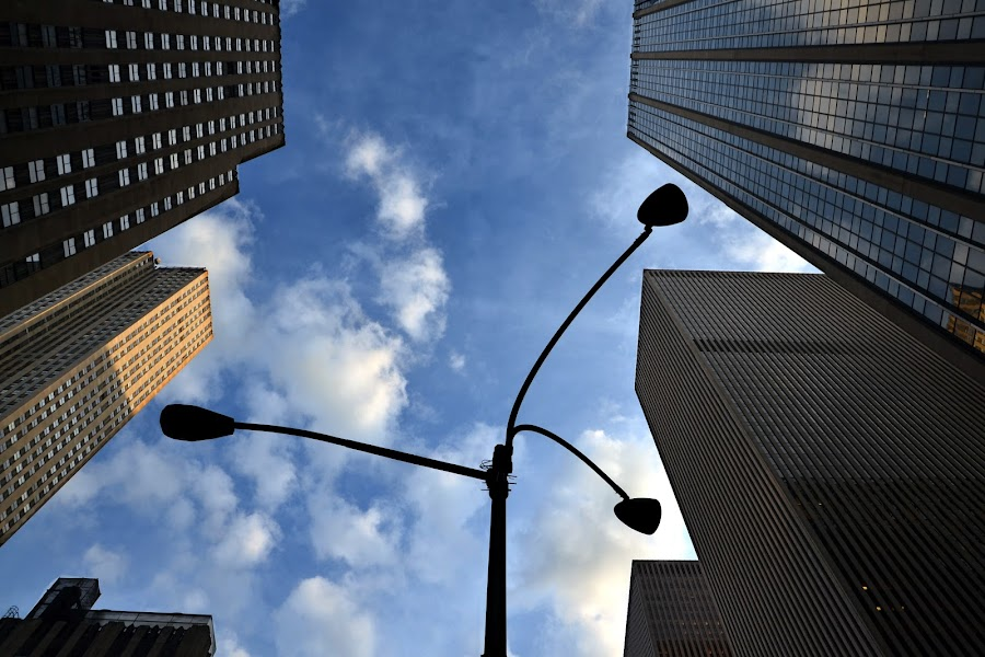Looking up by Valeria Carteri - City,  Street & Park  Vistas ( skyscrapers, manhattan, streetlights, new york )