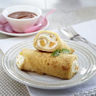 Blintzes Stuffed with Cream Cheese and Clementines.