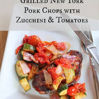 Grilled New York Pork Chops with Zucchini & Tomatoes.