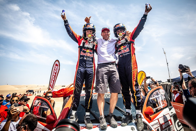 SA's Glyn Hall (centre) with Nasser Al Attiyah (right) and Mathieu Baumel. Picture: SUPPLIED