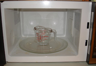 Photo: Set your glass measuring cup inside the microwave, and set the clock for 2 to 3 minutes, letting the Heinz Cleaning VInegar to boil and steam!