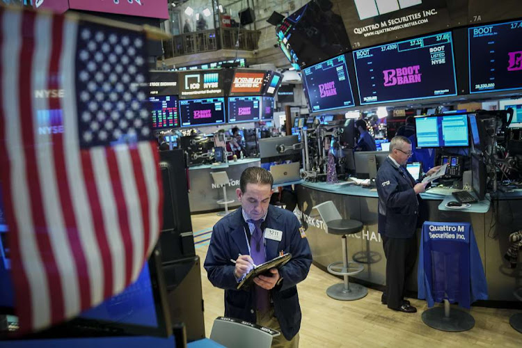 Traders and financial professionals work on the floor of the New York Stock Exchange ahead of the opening bell, January 4, 2019 in New York City. Picture: DREW ANGERER