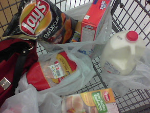 Photo: After all of my shopping is complete, it is time to check out. I checked off all items on my list as they were added and ended up with all items needed. As you can see, we needed whole milk and cereal for breakfast this week, chips to go with sandwiches this week, Easy Mac N Cheese for Liam (he's very picky, but loves these) and lastly we bought a whole chicken.