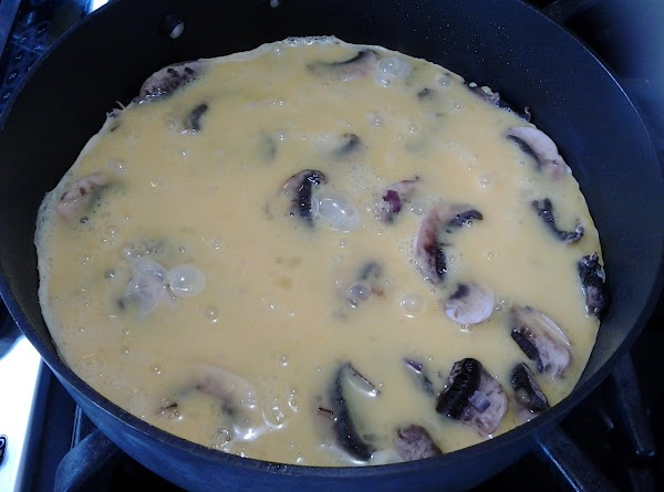 Whisk in half and half to beaten eggs, and pour mixture over mushrooms and...