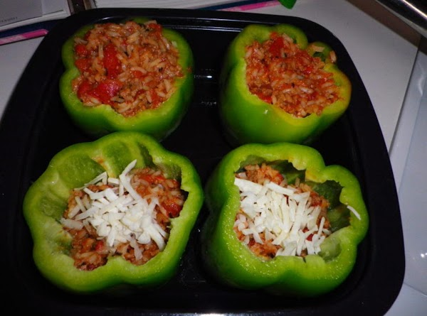 Prepare green bell peppers by cutting off top of pepper and cleaning out inside...