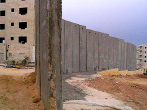 Photo: flimsy wall, Israeli Apartheid Wall in the occupied West Bank, encircling Palestinian villages, cutting Palestinians off from their land, separating families and neighbours, cutting off access to work, school, medical care.  Not about 'security'.