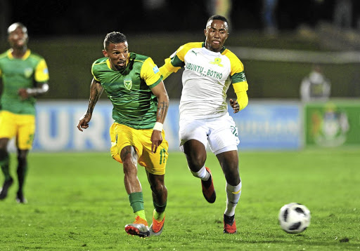 Lebohang Maboe of Mamelodi Sundowns, right, is challenged by Wayde Jooste of Arrows in Wednesday's clash.