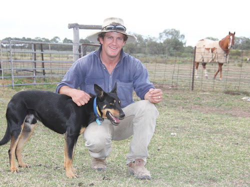 Damien Meppem on 'Murry Cummumualah' with one of his eight dogs.
