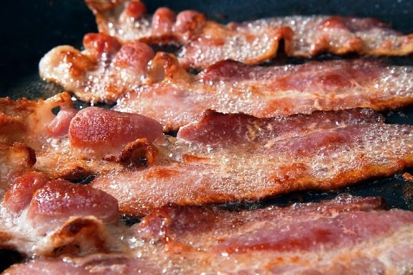 Fry bacon in deep skillet until evenly brown and crispy.