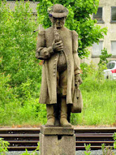 Photo: This figure greets you at the station, but I never found out who he was. A railway inspector?