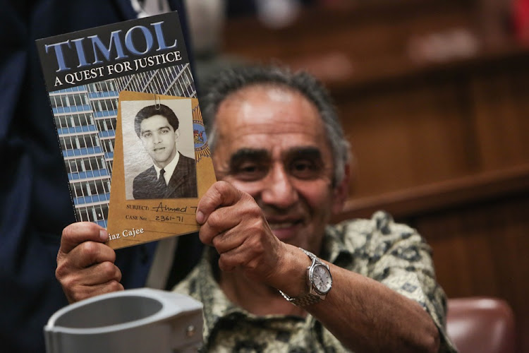 Ahmed Timol's brother, Mohammed, holds out a book written by his nephew Imtiaz Cajee ahead of the judgment into Ahmed's death at the North Gauteng High Court in Pretoria on 12 October 2017.