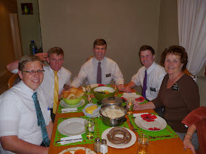 "Photo: Our motto was: ""Feed My Sheep!""  So these young Elders prepared our ""Last Supper,"" which included South African food."