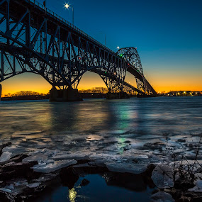 Ice Floats on the Niagara by John Witt - Buildings & Architecture Bridges & Suspended Structures ( shore ice, niagara river, sunrise, morning, south grand island bridge )