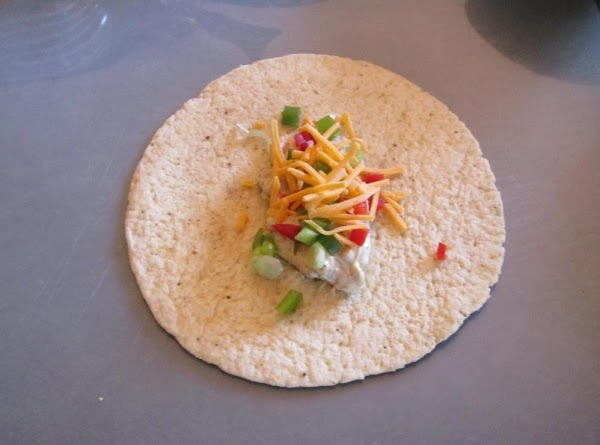 Place about  3 tablespoons  of filling on tortilla. Sprinkle onions, peppers and...