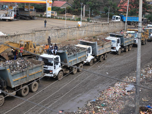 Garbage trucks line up awaiting clearance from the Dandora dumpsite weighbridge on August 16, 2018.