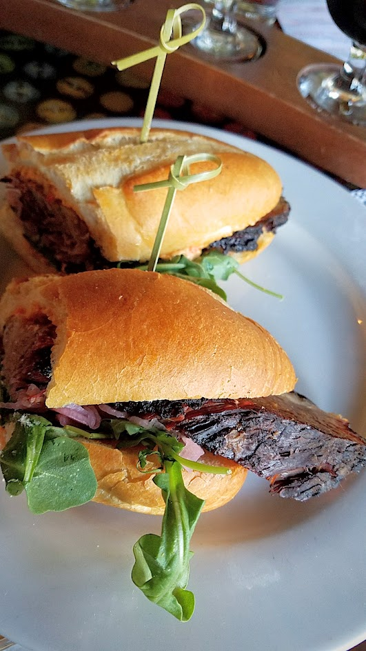 Example Food at Saraveza Smoked Brisket Sandwich with pimento cheese, red onion pickle, and arugula