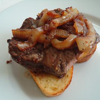 Open-Faced Steak and Onions on Garlic Toast.
