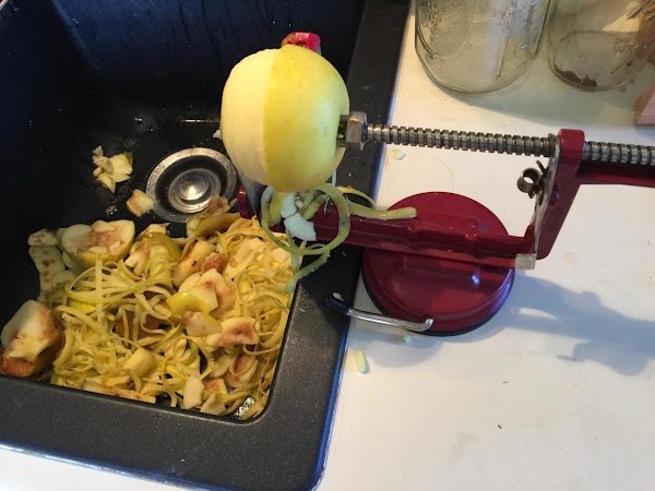 pre-heat oven to 425. Peel and slice apples very thin. Place in large bowl,...