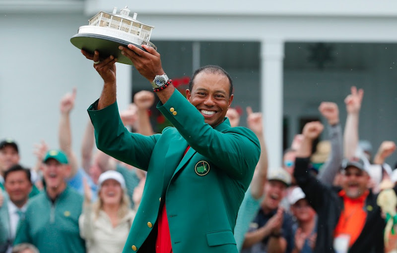 Tiger Woods celebrates 2019 Masters victory in his green jacket