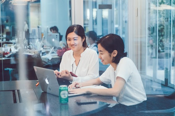 Women smiling at laptop, Program Overview, Sales Academy, Campus Seoul, Google for Startups