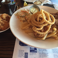 Fried fish, shrimp, onions and fries.