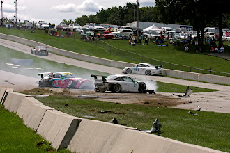 Photo: And then three GT3 cars, resting. That wall was straight seconds ago. Really good YouTube video of both IMSA GT3 races: http://www.youtube.com/watch?v=JPodwS3AOPA