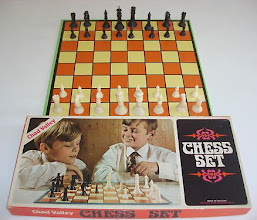 Photo: CV plastic chess set (not owned, seen on eBay)  Date unknown - but, based on the attire, 1960's perhaps? There is no sign of any Royal Warrant reference on the box.  The cover, at bottom right, states: 'MADE IN ENGLAND. CONTAINS SOME IMPORTED PARTS' - possibly the chessmen?  Yet another incorrectly set-up chess board!