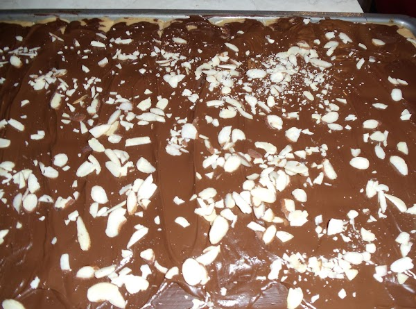 Sprinkle with remaining almonds and allow candy to cool completely and and chocolate to...