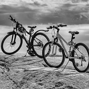 by Jørgen Schei - Black & White Objects & Still Life ( cloudy, rocks, bicycles, two, summer, sea )