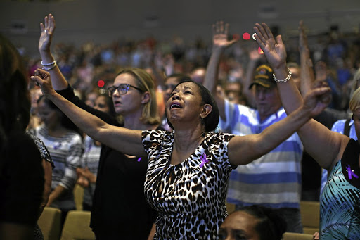 These congregants are clearly overcome by emotion during worship in church, a place the writer vows he'll never return to.