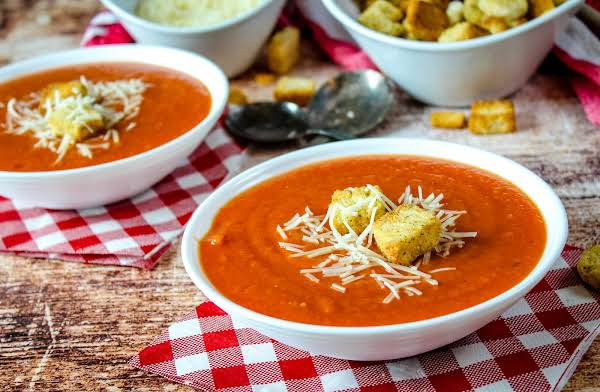Two Bowls Of Rustic Farm Fresh Tomato Soup.