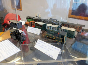 Photo: 017 Some of the superb selection of 009 locos and stock that were on display behind the anti-photographic perspex screen on the 009 publicity display. This selection features models mainly built by Charles Insley .