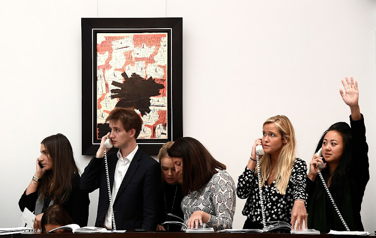 Advancing: Telephone bids during an auction at Sotheby's in London. E-commerce allows more flexible ways of buying art from a distance. Picture: REUTERS