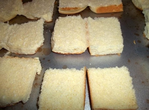 Turn oven on to 375 degree F.  On a sheet pan, lay opened sandwich rolls...