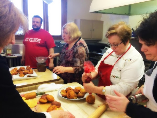 Here we are filling and dusting the paczki!   VERY TRADITIONAL FILLINGS FOR PACZKI...