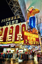 """Photo: In 1947 Las Vegas chamber of Commerce hired a West-Marquis firm which invented the Fremont Street Cowboy Vegas Vic and his friendly """"Howdy Podner"""" greeting.The Young Electric Sign Company was commissioned to build the neon version of the sign by the owners of the Pioneer Club. They then commissioned Pat Denner who modeled it after the image used by the Las Vegas Chamber of Commerce in 1947 consisting of a cowboy in blue jeans with a yellow-checked shirt and red bandanna. Vegas Vic was then erected on the exterior of the building in 1951 changing the exterior of The Pioneer club forever."""