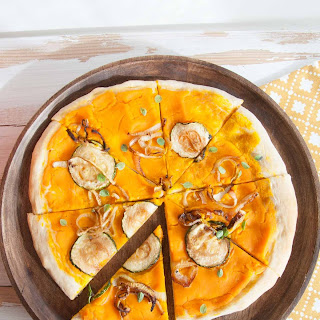 Vegan Pumpkin Pizza with zucchini & caramelized onions.