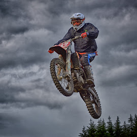Free Sight by Marco Bertamé - Sports & Fitness Motorsports ( clouds, speed, number, race, noise, jump, flying, red, motocross, 42, blue, air, grey, high )