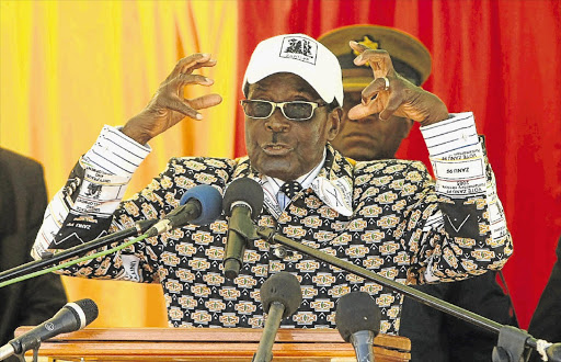 Robert Mugabe addresses supporters at the White City Stadium in Bulawayo. File photo.