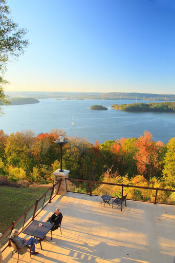 View-of-River-with-Couple.jpg - Guests on a lodge patio with a view of Guntersville Reservoir and Lake Guntersville Resort State Park in Guntersville, Ala.