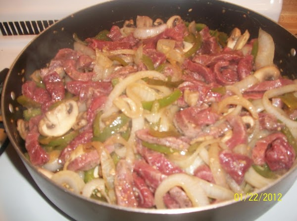 Sprinkle the beef strips with salt and pepper and add to skillet and saute...