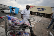 File photo of businessman Phillip Sibia queuing to return meat from the Enterprise Factory store in Germiston, East of Johannesburg. This comes after it was found that the recent outbreak of listeriosis was traced to a Enterprise Foods, owned by Tiger Brands, facility in Polokwane.
