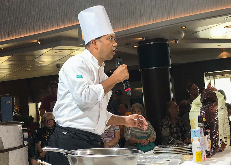 A chef instructs participants during a cooking demo on Norwegian Jade.