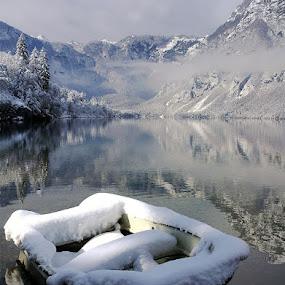 Snowbound by Anuška Vončina - Transportation Boats ( water, mountains, winter, snow, lake, landscape, boat, bohinj )