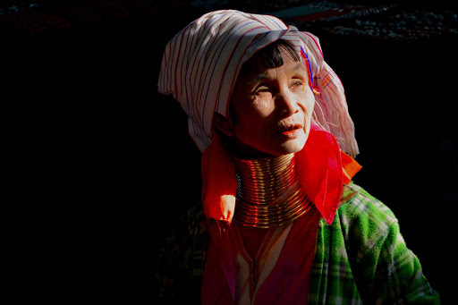 local-woman - Minority woman weaving near a temple along Inle Lake. Check out the traditional neck piece she wears,
