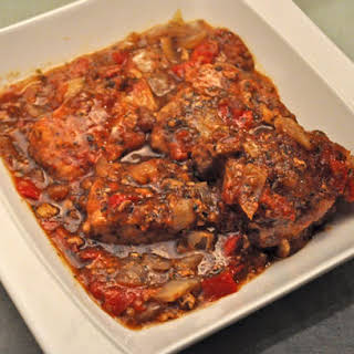 Slow Cooker Pork Chops with Peppers and Tomatoes.