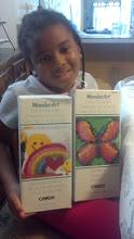 Photo: Kaleya holds her two new kits