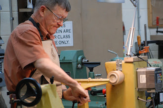 Photo: He adjusts the rest during the hollowing of the top of the box.