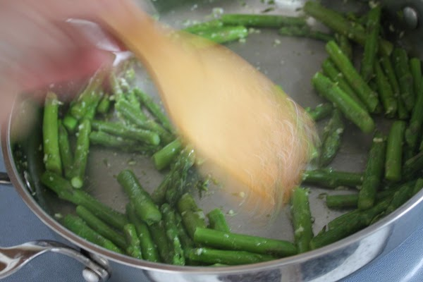 Meanwhile, in a sauté pan heat olive oil. Add garlic and cook until golden,...